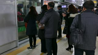 Asian people, tourists and Korean commuters waiting for subway train arriving in underground station in Seoul, South Korea, Asia. Railway, transport, transportation, travel