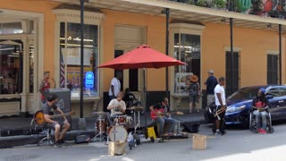 Band playing and singing in the French Quarter of New Orleans, Louisiana, United States of America. Music show on the street in the USA with artists performing