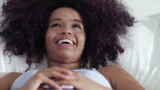 Black Girl Writing Love Message On Cell Phone In Bed