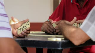 Black Man Talking To Friend During Domino Game