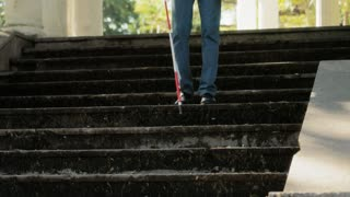 Blind Man Walking And Descending Steps In City Park