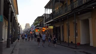 Bourbon Street in the French Quarter of New Orleans, Louisiana, United States of America. Urban view of American city with old buildings and people walking at night
