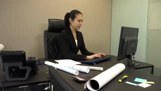 Busy Asian people at work in executive office. Beautiful Japanese business woman working with computer in corporate studio. Successful businesswoman and female manager