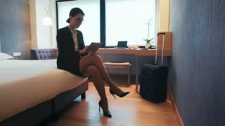 Busy Female Manager Woman Businesswoman With Tablet In Hotel Room