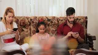 Busy Hispanic Family At Home Using Mobile Phones Telephones Smartphones