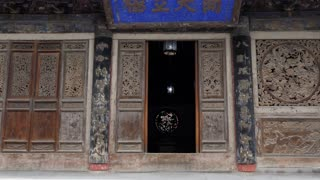 Carved doors at Fuxi Temple (Fuxi Miao) in Tianshui, Gansu province, China, Asia. Old monument and traditional religion