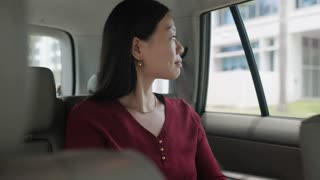 Chinese Business Woman Working In Taxi Going To Work