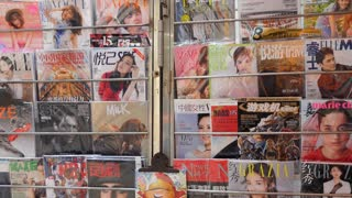 Chinese fashion magazines, comics and glossy press for sale in a kiosk in Beijing, China, Asia