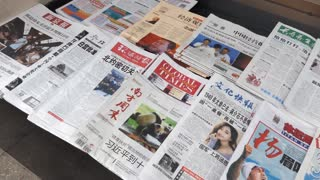 Chinese newspapers and press for sale in a kiosk in Beijing, China, Asia