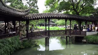 Chinese people and tourists visiting the Humble Administrator's Garden in Suzhou, China, Asia, a UNESCO World Heritage Site. Asian travel and tourism