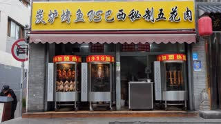 Chinese restaurant in Beijing, China, Asia. Traditional food shop in local market selling Peking roast duck, fish and meat
