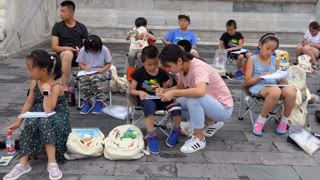 Chinese school children learning drawing and painting with teacher in Beijing, China, Asia