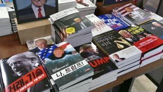 Close-up of Korean book covers with US president Donald Trump. Shop, store selling books, printed material in bookstore, Seoul, South Korea, Asia