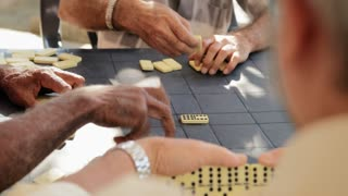 Close Up Of Male Hands Playing Domino Game