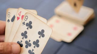Closeup Of Male Hands Holding Cards During Game