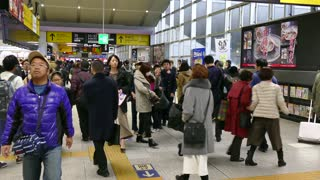 Crowd, Japanese people and commuters running and walking with suitcases, luggage, bags and baggage at Kyoto JR Railway Station in Kyoto, Japan, Asia during rush hour