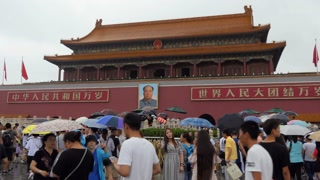 Crowd, people and Chinese tourists entering the gate of the Forbidden City in Beijing, China, Asia. Travel in the rain, holidays and tourism