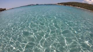 Crystal clear sea water in Punta Molentis, Villasimius, Sardegna, Italia. Italian coast in Sardinia on Mediterranean Sea. Ultra wide angle