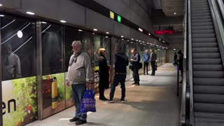 Danish people, tourists and commuters waiting for subway train arriving at underground metro station in Copenhagen, Denmark, Europe. Railway, transport, transportation, travel