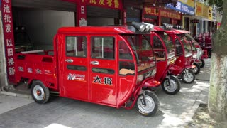 Dealer shop selling electric vehicles in Guilin, China, Asia. Scooters for sale in Chinese city, clean transportation