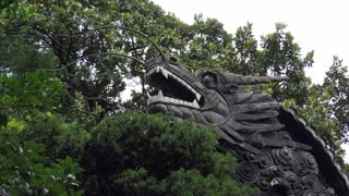 Decoration with dragon at Yu Garden, famous tourist attraction and traditional old Chinese building in Shanghai, China, Asia. Art, artwork, monument, landmark at Yuyuan Garden