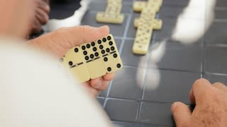 Detail Of Male Hands Playing Domino Game