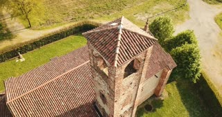 Drone flying over an old church in Cavenago di Brianza, Lombardy, Italy. Aerial view of Italian landscape with old building and landmark. Medieval monument seen from the sky