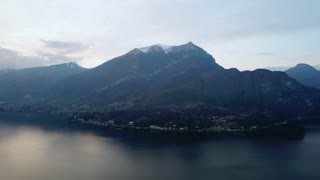 Drone flying over Bellagio, Lake Como, Lombardy, Italy. Aerial view of charming Italian town seen from the sky