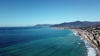Drone flying over Pietra Ligure, Liguria, Italy. Aerial view of charming Italian sea town and coast seen from the sky