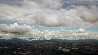 Drone flying over Po Valley east of Milan in Lombardy, Italy. Aerial view of Italian highly developed region seen from the sky, with the Alps in the background