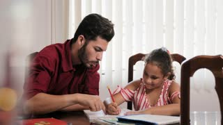 Education With Dad Helping Daughter Doing School Homework At Home