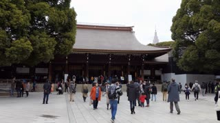 Exterior of Meiji Jingu or Meiji Jingo Shrine in Tokyo, Japan, Asia. People and tourists during visit
