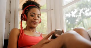 Girl Listening Music With Red Headset And Singing