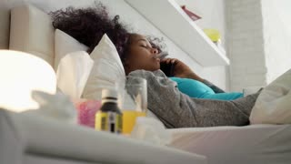 Girl With Fever Using Thermometer Calls Doctor By Phone