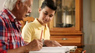 Grandfather Teaching Grandchild Studying For School Education