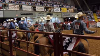 Group of American cowboys at rodeo in Cowtown Coliseum, arena in the stockyards of Forth Worth, Texas, United States of America
