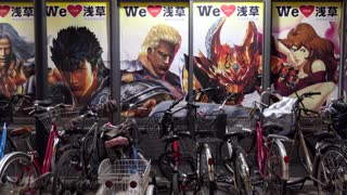 Group of bicycles in a free parking for bikes in Tokyo, Japan, Asia. Cycles and Japanese manga posters in Asakusa district. Clean transportation vehicles