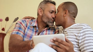 Happy Gay Couple Homosexual People Men Kissing And Using Computer