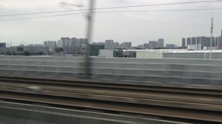 High speed bullet train traveling between Shanghai and Suzhou, China, Asia. Modern Asian transportation, fast travel, Chinese city landscape