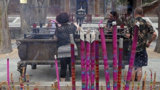 Incense sticks burning at Fuxi Temple (Fuxi Miao) in Tianshui, Gansu province, China, Asia. Chinese people praying. Old monument and religion