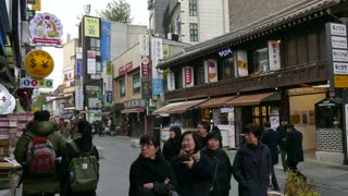 Insadong or Insa-dong district, Seoul, South Korea, Asia. View of the Korean capital city with people shopping, tourists, signs. Famous tourist spot, Asian travel attraction, shops, stores