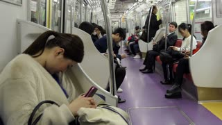 Japanese people on underground train during rush hour in Tokyo, Japan, Asia. Tourists on subway train. Asian commuters traveling