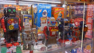 Japanese shop in Tokyo, Japan, Asia. Store selling old toys, collectibles, memorabilia and vintage dolls in shopping mall