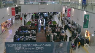 Lotte Shopping Mall in Seoul, South Korea, Asia. Korean people, tourists, crowd shopping in shops and stores. View from elevator