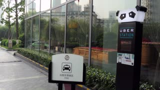 Luxury hotel with stop for people waiting for a taxi, Uber cars and rental vehicles in Chengdu, Sichuan, China, Asia