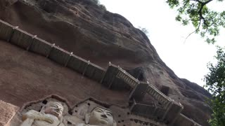 Maijishan Grottoes near Tianshui, Gansu province, China, Asia. Site, caves and caverns with giant Buddha and Buddhist statues. Chinese art, landmark, rock architecture, monument carved in stone