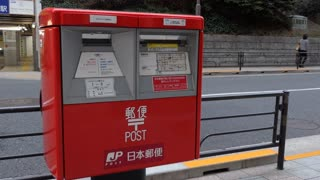 Mailbox for letters, mail, correspondence in Tokyo, Japan, Asia. Japan Post letter box in Japanese street