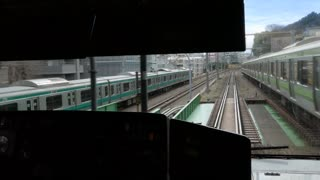 Man driving local train on JR railway system in Tokyo, Japan, Asia. Railways, transport, transportation, travel. View of the interior