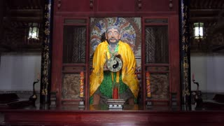 Man praying at Fuxi Temple (Fuxi Miao) in Tianshui, Gansu province, China, Asia. Old monument and traditional religion