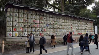 Monument made of sake barrels near Meiji Jingu or Meiji Jingo Shrine in Tokyo, Japan, Asia. People and tourists during visit